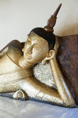 Reclining gold Buddha
