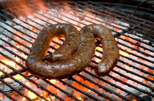 Tradtional South African braai barbecue borewors sausage on fire