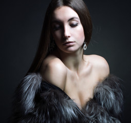 young woman in a fur coat.