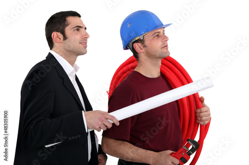 a plumber and a manager watching something
