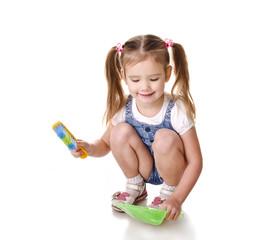 Cute little girl sweeps a floor isolated