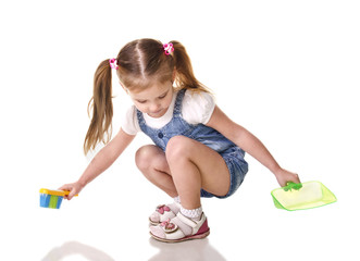 Cute little girl sweeps a floor isolated