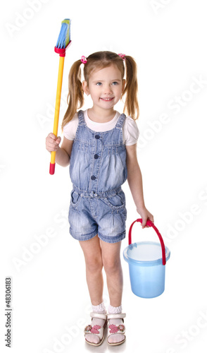 Cute little girl with mop and bucket is ready to clean