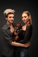 stylish young couple with dog