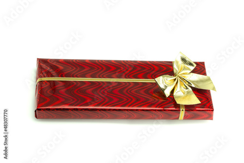 Red gift with a bow tied up by a ribbon