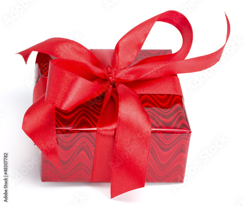 Red gift tied up by a bow