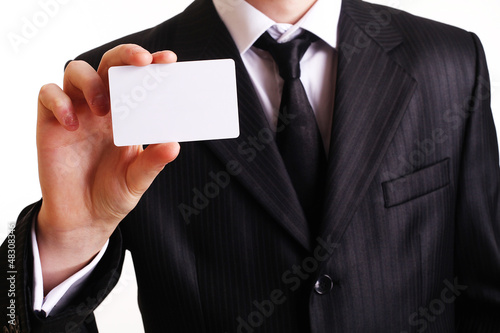 Businessman showing his business card. You can just add your tex