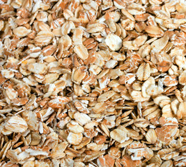 Oat flakes heap background