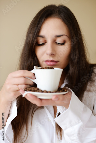 brunette enjoying smell of coffee