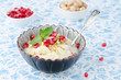 semolina dessert with pomegranate seeds and pistachios in a bowl