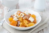 salad with persimmon, mandarin oranges and goat cheese