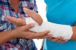 Woman with a broken arm and her caregiver