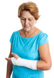 Woman with a broken arm on a plaster cast (isolated on white)
