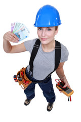 Electrician with a handful of cash