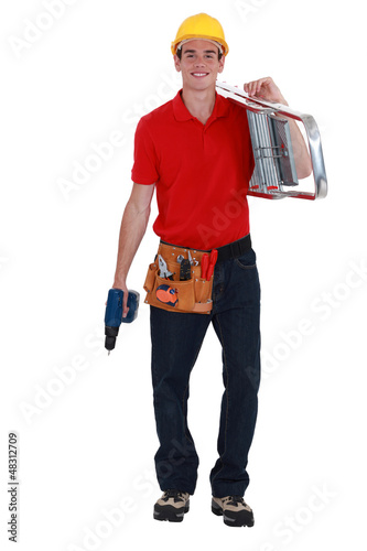 happy young carpenter carrying ladder isolated on white