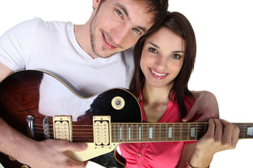 Couple with electric guitar
