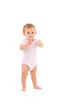 Cute baby standing unstable