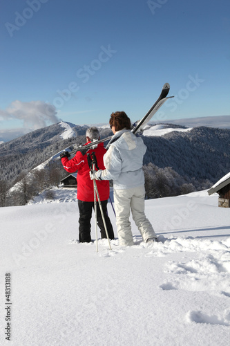 Old couple skiing