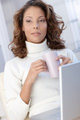 Attractive female with laptop and tea