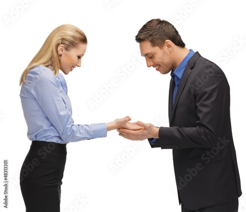 man and woman showing something on the palms