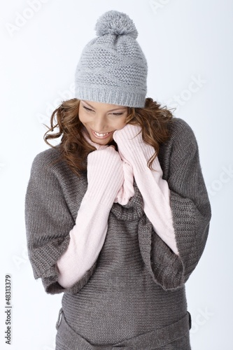 Happy woman laughing in winter outfit