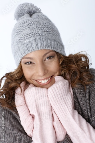 Beautiful ethnic girl smiling in winter outfit