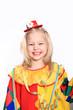 kleines Mädchen als lachender Clown