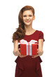 teenage girl in red dress with gift box