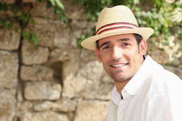man with sunhat posing outdoors