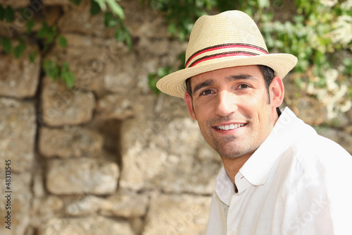 man with sunhat posing outdoors