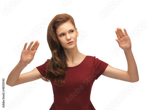 girl in red dress working with something imaginary