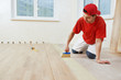 parquet worker adding glue on floor