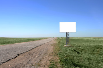 Blank billboard in desert