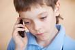 Sad boy, talking on the phone