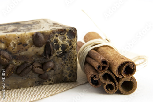 spa composition with natural soap and cinnamon sticks