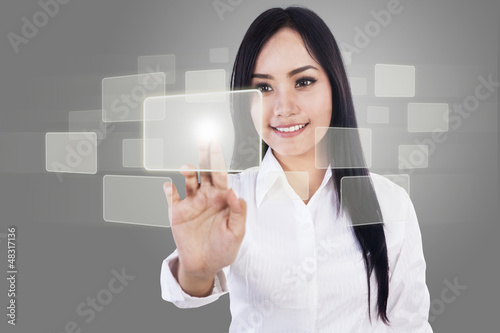 Beautiful businesswoman and touch screen