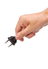 Man is holding a black outlet in the hand