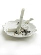 broken cigarette on white ash-tray
