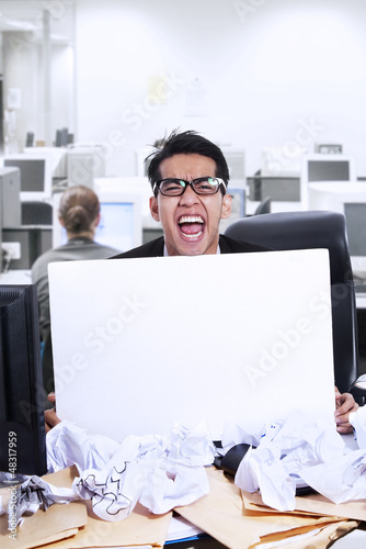 Businessman scream and blank paper