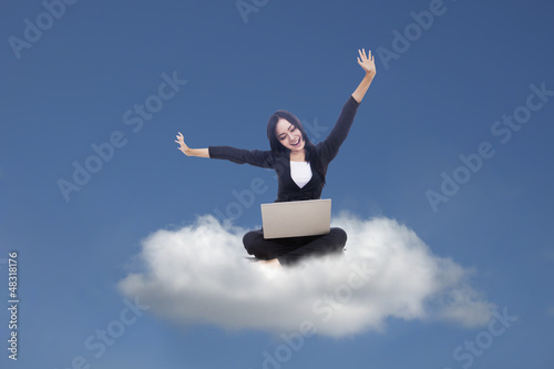 Businesswoman and cloud computing