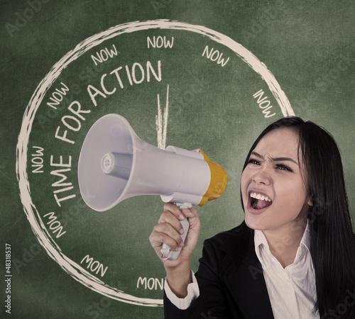 Businesswoman scream using speaker