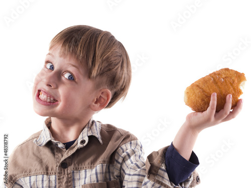 young boy eating donut