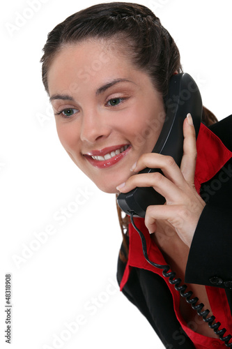Brunette using land-line telephone