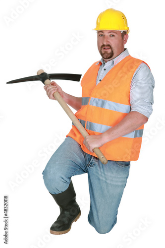 Worker using a pickaxe