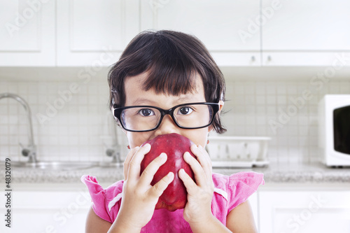 Nerd toddler in the kitchen