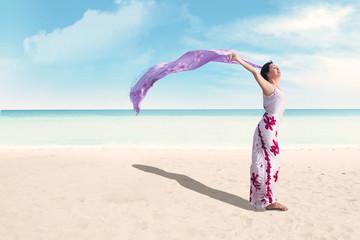 Woman enjoying holiday at beach