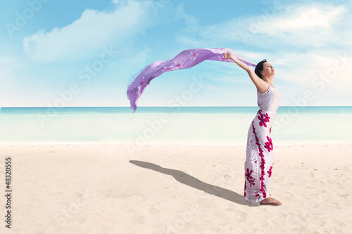 Woman enjoying holiday at beach