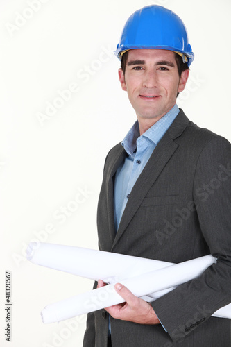 Architect holding rolled plan under arm