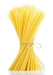 Linguine pasta tied with old rope isolated on white background