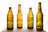 Four Beer Bottles on the Table